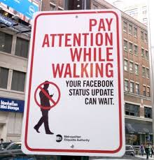 Pay attention while walking facebook sign