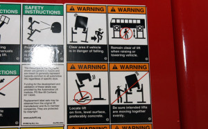 Safety sign for car lift